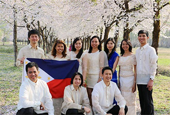 JDS Fellows from the Philippines photographed under a cherry tree
